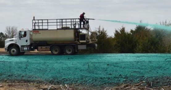 Image of hydroseeding process with truck-mounted sprayer