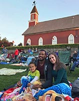 photo of family at movies on the green event