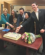 Photo of Novato Council cutting cake