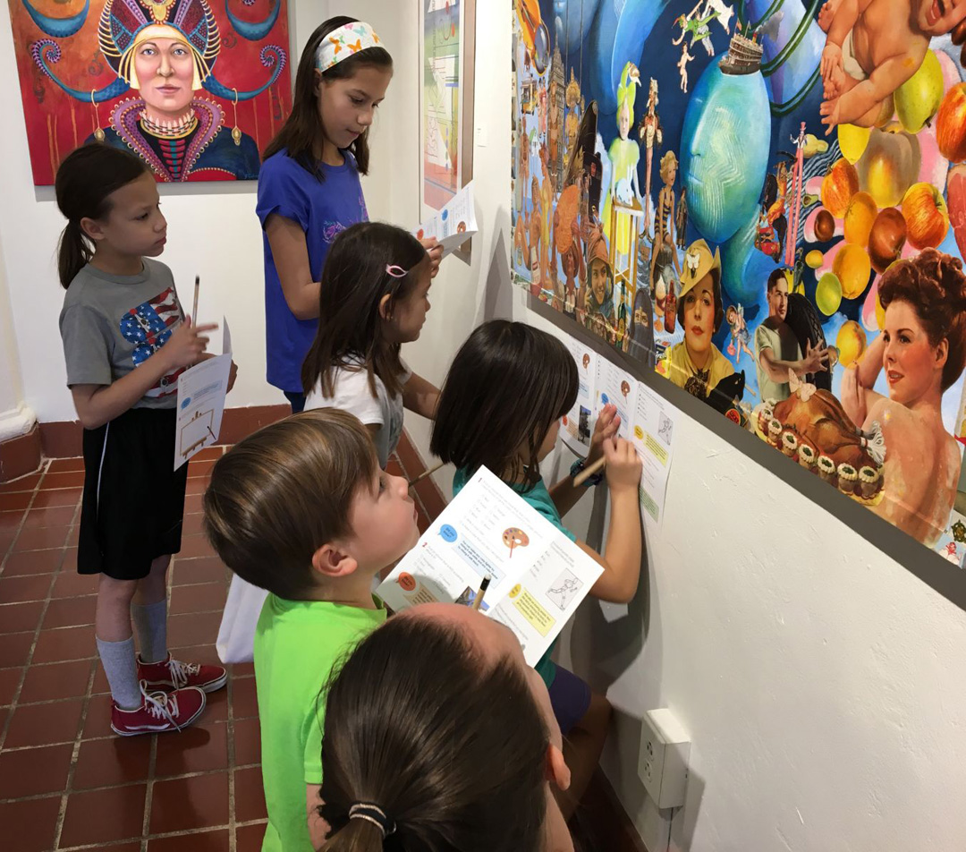 Image of children looking at art.