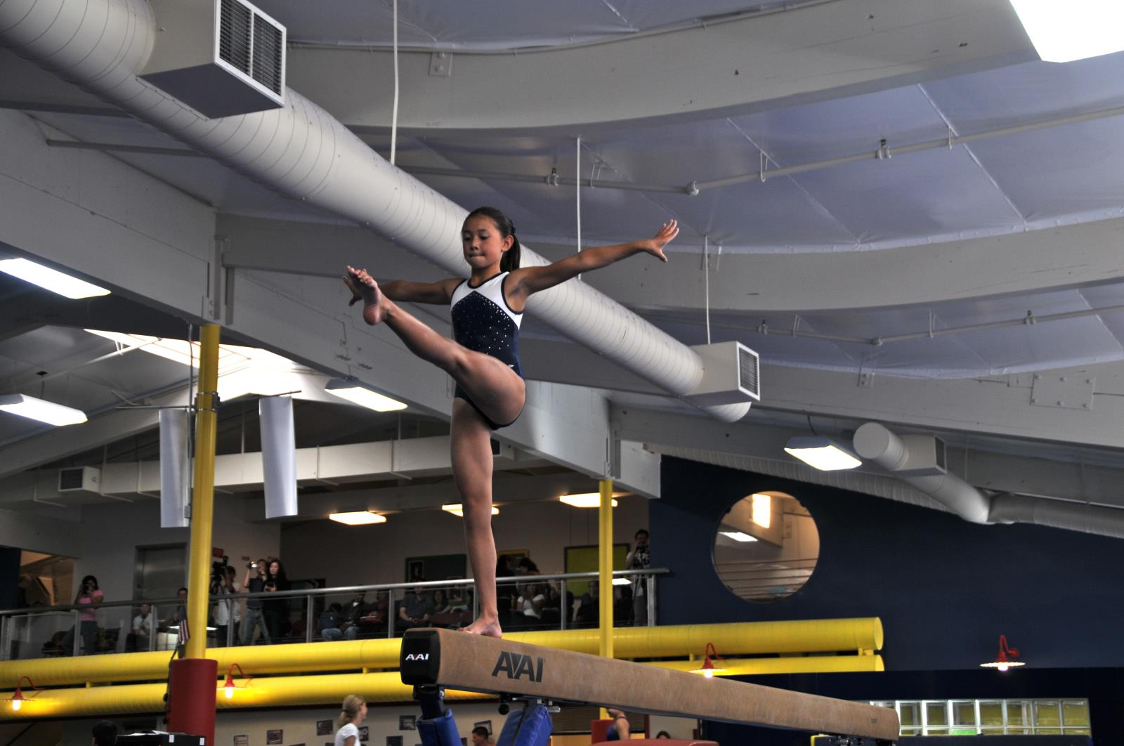 Competitive Gymnast on Balance Beam