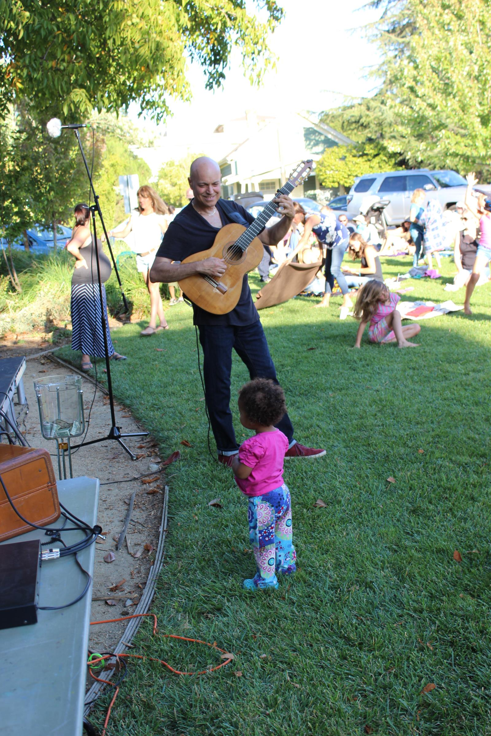 Freddy Clarke plays to younger audience member