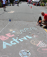 Image of child writing with chalk on the street