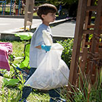Image of kid cleaning up litter